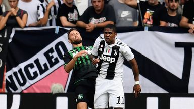 Douglas Costa of Juventus clashes with Sassuolo's Federico Di Francesco during Sunday's Serie A match