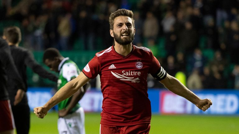 Aberdeen captain Graeme Shinnie celebrates winning the tie at Easter Road on Tuesday in the League Cup quarter-final against Hibs