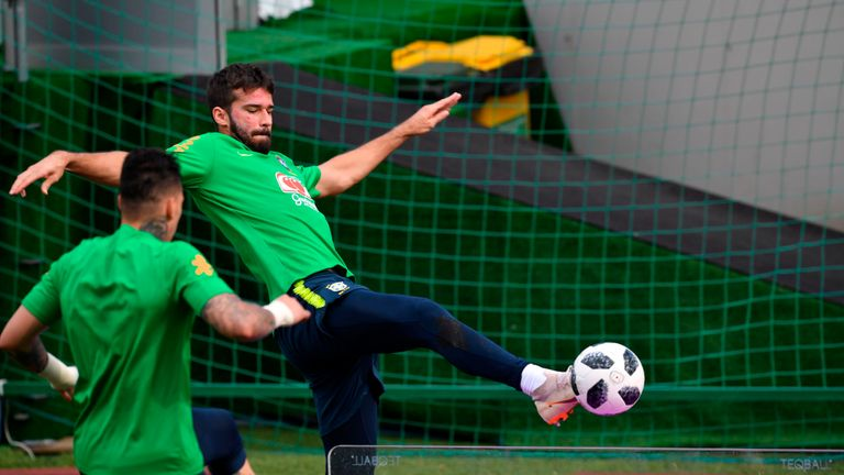 Alisson and Ederson compete over a table-tennis table during training for Brazil