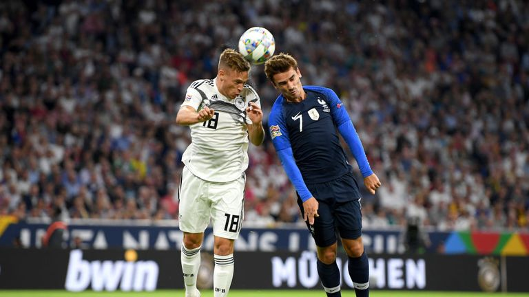 Antoine Griezmann (R) and Joshua Kimmich vie for a header
