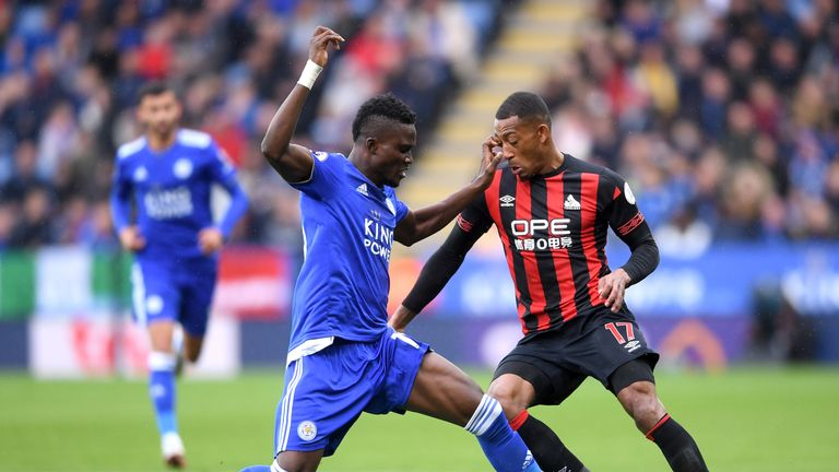 Daniel Amartey (L) battles for possession with Rajiv van La Parra (R)