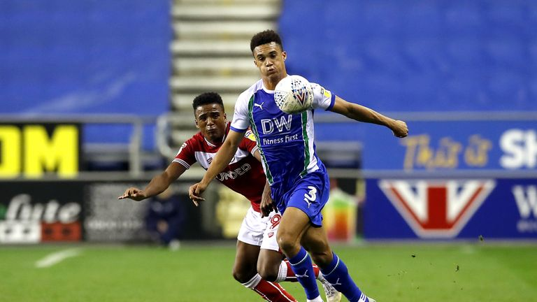 Bristol City's Niclas Eliasson (left) and Wigan Athletic's Antonee Robinson (right) battle for the ball during the Sky Bet Championship match at the DW Stadium, Wigan