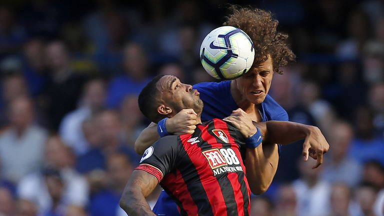 Callum Wilson competes for a header with David Luiz