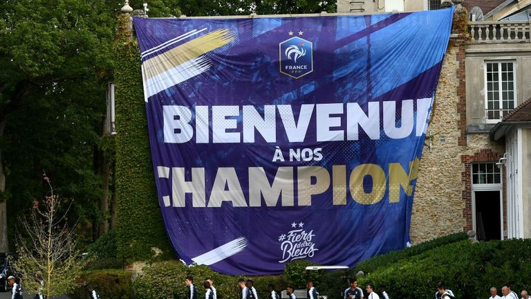 A large banner congratulating France on their World Cup win greeted the players at Clairefontaine