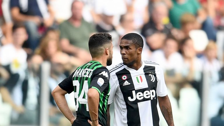 Douglas Costa was sent off in stoppage time after video cameras caught him spitting at Federico Di Francesco