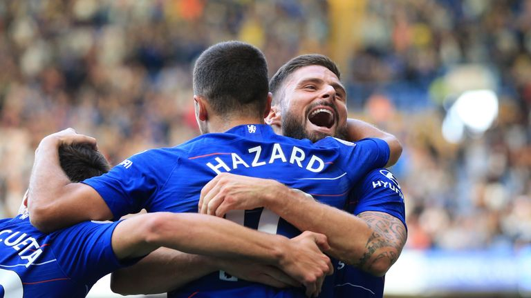 Eden Hazard celebrates with Olivier Giroud after the two combine in Chelsea's 4-1 win over Cardiff