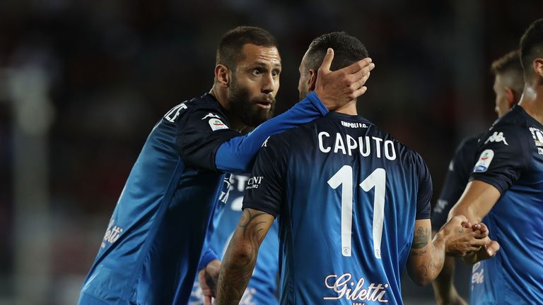 Empoli celebrate Caputo's goal after he brings them level against Milan