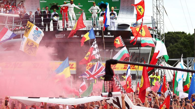 Hamilton celebrates in front of the Tifosi after winning at Monza last year