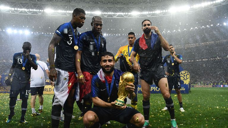 Fekir poses with the World Cup after the final