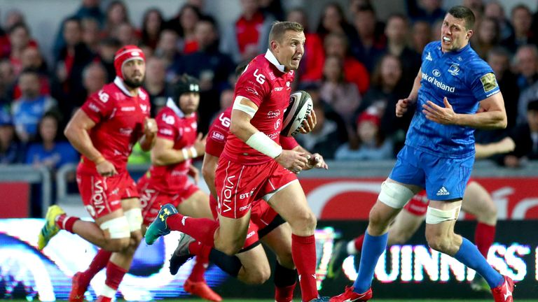 Hadleigh Parkes makes a break against Leinster at Parc y Scarlets