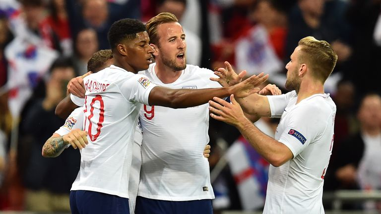 Marcus Rashford celebrates his opening goal with Harry Kane, Luke Shaw and Kieran Trippier