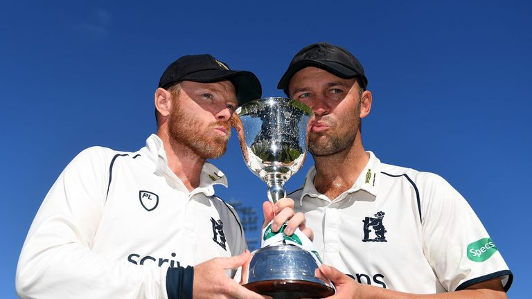 Ian Bell and Jonathan Trott of Warwickshire pose with the trophy after winning Division Two during Day Three of the Specsavers County Championship Division Two match between Warwickshire and Kent at Edgbaston on September 26, 2018 in Birmingham, England.  (Photo by Harry Trump/Getty Images)