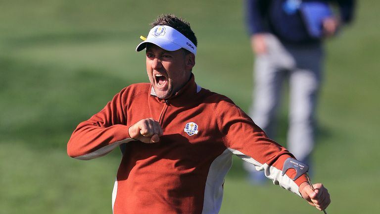 Poulter celebrates after sinking a putt