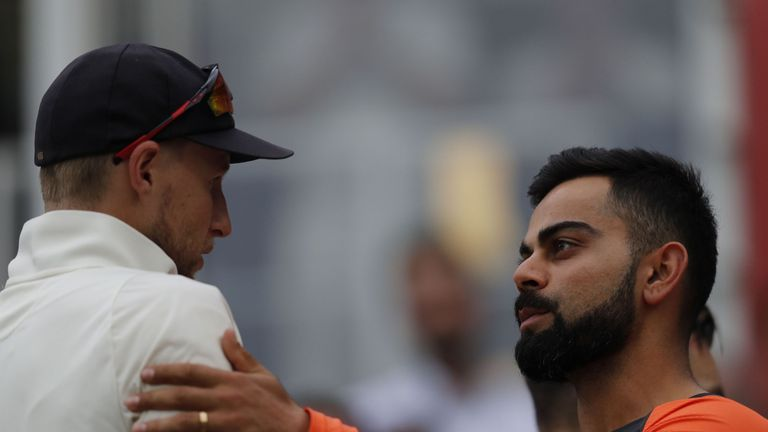 Joe Root and Kohli shake hands after England beat India in the fifth Test at The Oval