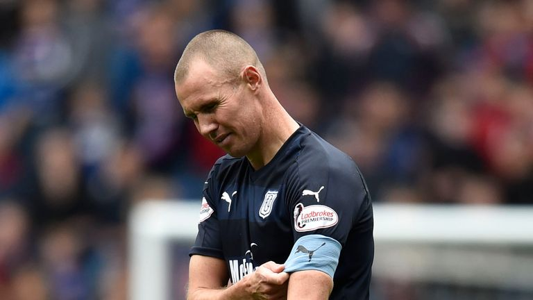 Dundee's Kenny Miller leaves the field after his red card