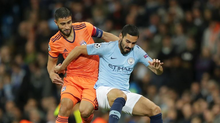Nabil Fekir and Ilkay Gundogan tussle for the ball