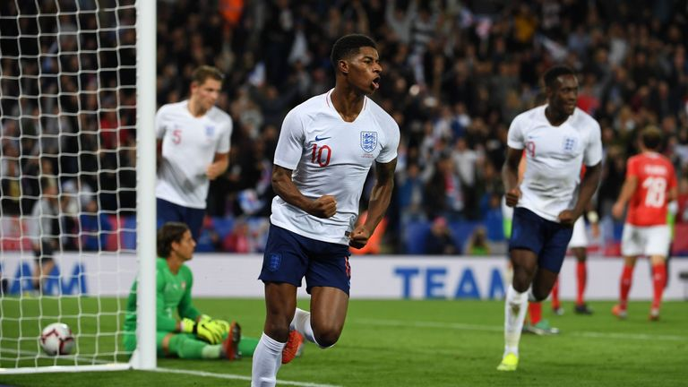 Marcus Rashford celebrates after scoring for England against Switzerland