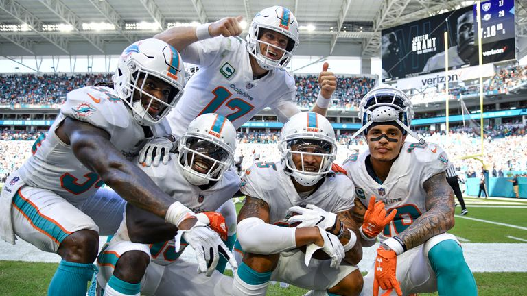 The Dolphins celebrate during their Week Three win over the Raiders that moves them to 3-0 on the season