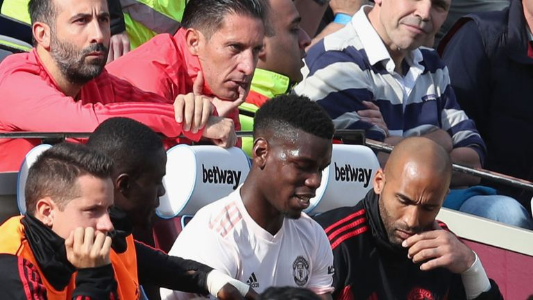 Paul Pogba takes his place on the bench after his substitution