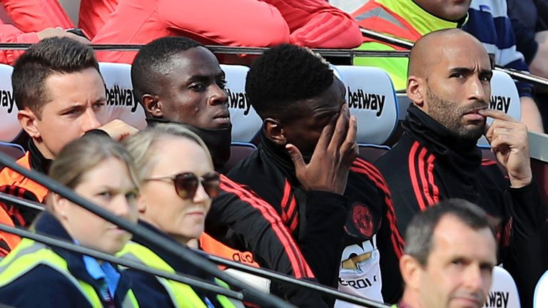 Paul Pogba on the Manchester United bench alongside team-mates Ander Herrera, Eric Bailly and Lee Grant