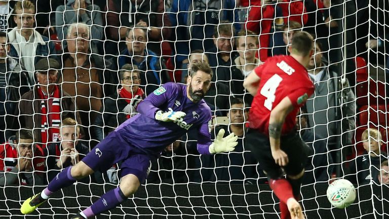 Scott Carson saved from Phil Jones to settle the shootout