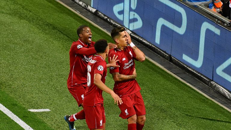 Roberto Firmino celebrates by covering one eye after scoring Liverpool's injury-time winner against Paris Saint-Germain at Anfield