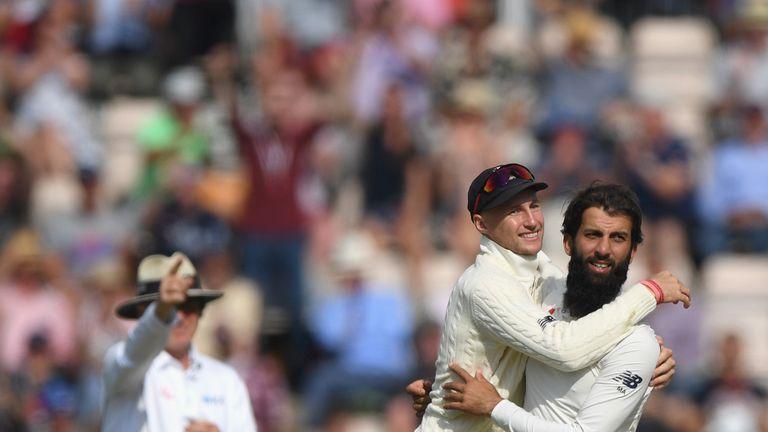 Moeen Ali celebrates a wicket with England skipper Joe Root