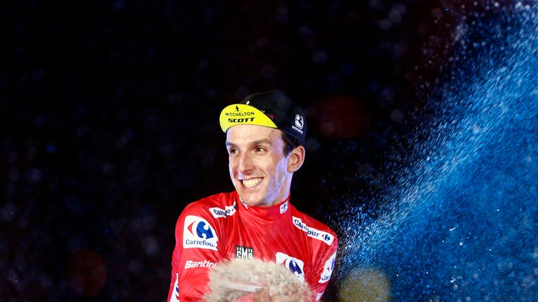 Simon Yates sprays champagne after winning the 2018 Vuelta a Espana