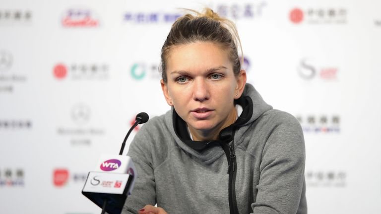 Simona Halep speaks to the media after retiring from her match in Beijing