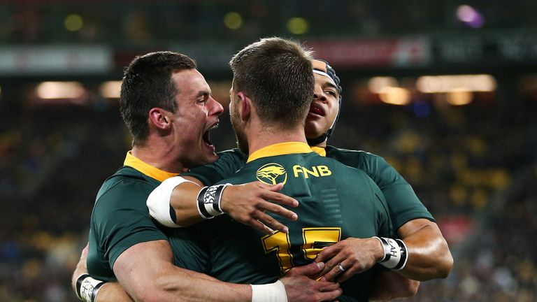 Cheslin Kolbe, Willie Le Roux, Jesse Kriel celebrate South Africa's victory over New Zealand in the Rugby Championship
