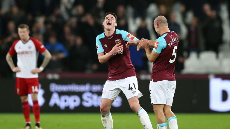 Pablo Zabaleta (R) jokes with Declan Rice