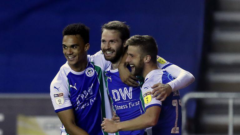 Nick Powell celebrates Wigan's winner