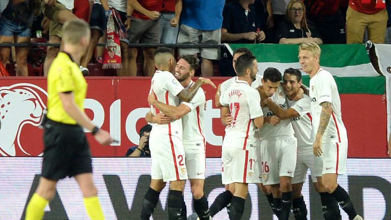 Sevilla players celebrate Wissam Ben Yedder's goal