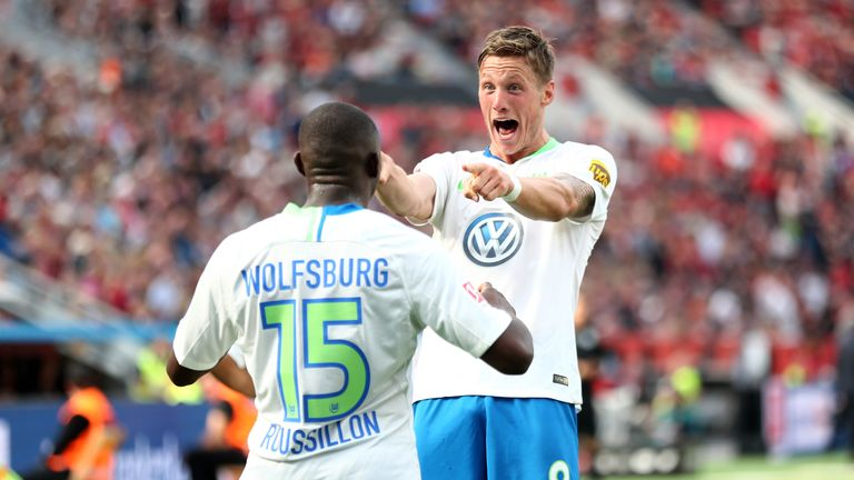 Wout Weghorst celebrates giving Wolfsburg the lead against  Bayer Leverkusen