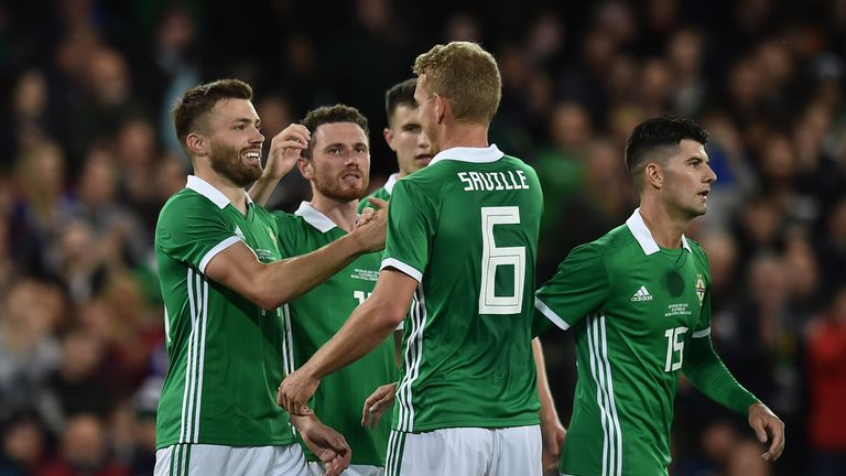 Stuart Dallas (left) celebrates after putting Northern Ireland 2-0 up