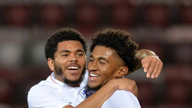 Reiss Nelson  (right) celebrates with team-mate Jay DaSilva after scoring his team's first goal against Scotland