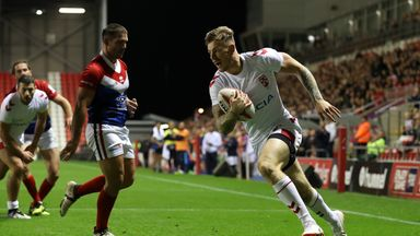 England's Tom Johnstone goes over for a try against France