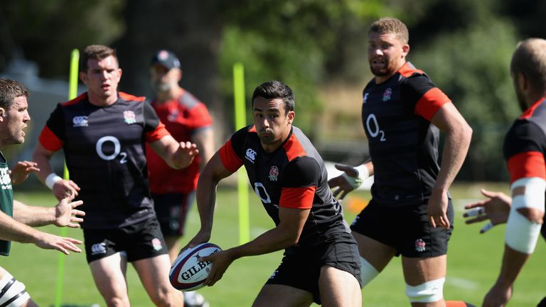 Alex Lozowski off loads the ball during the England training session held at the Lensbury Club on August 5, 2018 in Teddington, England.