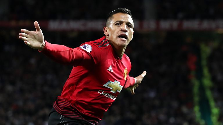 Alexis Sanchez celebrates after scoring the winner