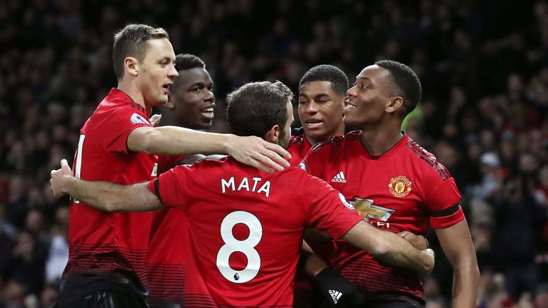 Anthony Martial celebrates scoring against Everton with his Manchester United team-mates