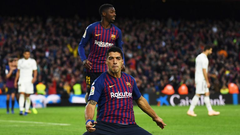 Luis Suarez scored a hat-trick as Barcelona thumped Real Madrid