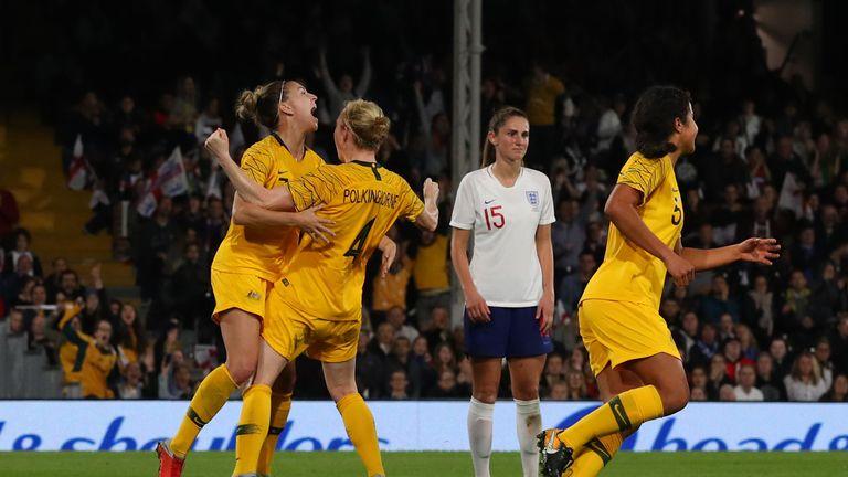 Clare Polkinghorne celebrates after scoring against England