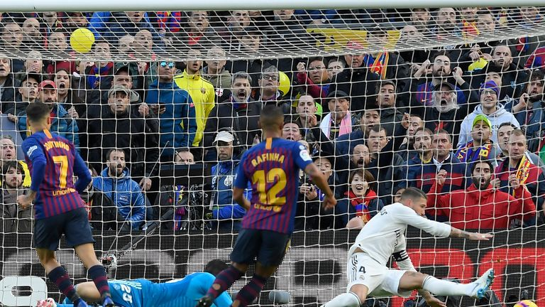Philippe Coutinho guides the ball into the net to give Barcelona the lead