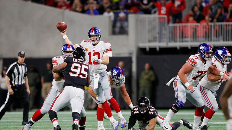 Eli Manning #10 of the New York Giants passes the ball during the second quarter against the Atlanta Falcons at Mercedes-Benz Stadium on October 22, 2018 in Atlanta, Georgia.
