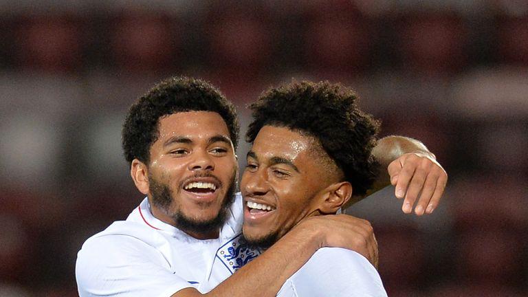 Reiss Nelson of England U21 celebrates with teammate Jay DaSilva after scoring his team's first goal against Scotland