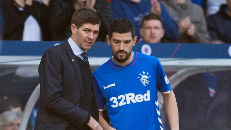 Rangers manager Steven Gerrard speaks to Graham Dorrans