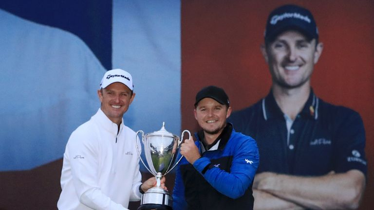 Eddie Pepperell holds his Sky Sports British Masters trophy alongside tournament host Justin Rose