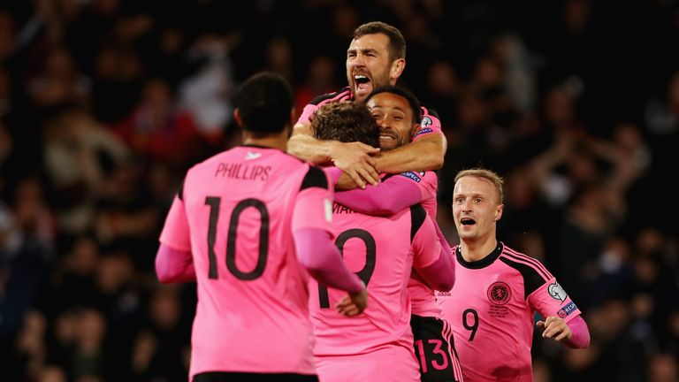 McArthur celebrates with teammates during one of his final games for Scotland, against Slovakia in October 2017