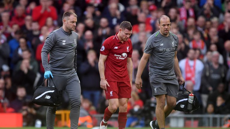 James Milner leaves the pitch after picking up an injury