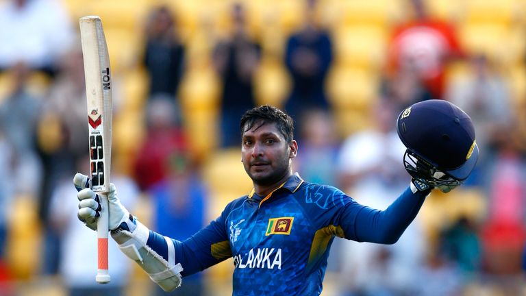 Kumar Sangakkara raises his bat after scoring a century against England in the 2015 World Cup